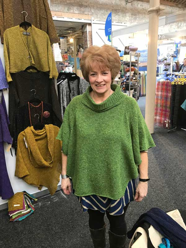 Karin Scott of Celtic Crossing wearing a green Argyll Ponchover